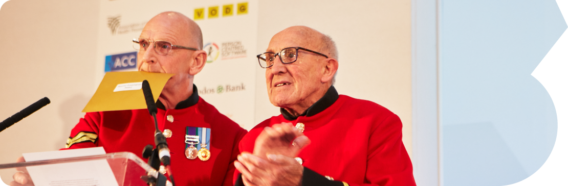 Chelsea pensioners presenting a third sector award