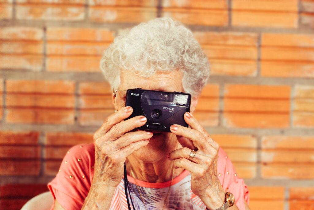 elderly lady with camera